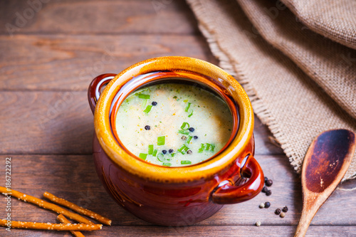 Cheese soup, bread sticks and wooden spoon  - 186722292