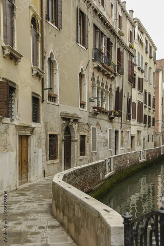 VENICE - ITALY, APRIL 18, 2009: Typical picturesque romantic Venetian canal - Venice, Italy