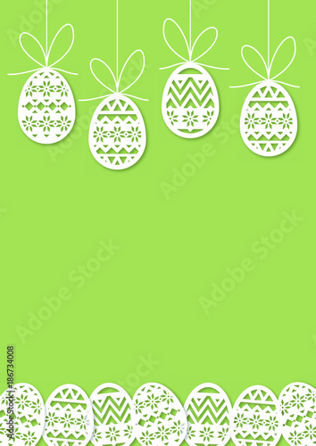 Easter - eggs hangs on the thread - green background - 186734008