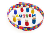 Autism inscription with figures and Puzzle pattern ribbon on white background