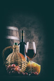 Wine still life with barrel and red wine with grapes - 186741043