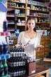 female cashier standing in art shop