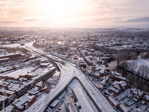 Foto op Canvas Parijs Aerial view of snow covered rail and road networks. Snow, ice and winter weather conditions close railway links and shut roads causing transport delays and dangerous conditions.