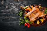 Baked turkey with vegetables and spices. Thanksgiving day. Goose chicken grill. On a wooden background. Top view. - 186747473