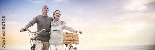 Happy senior couple with their bike - 186756081
