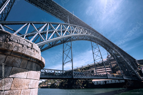 Foto op Aluminium Schip Dom Luiz bridge and Douro River , Porto , Portugal. Iron Bridge Construction concept.