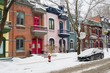 Row houses with colorful facades in the Plateau neighborhood in Montreal, in winter.