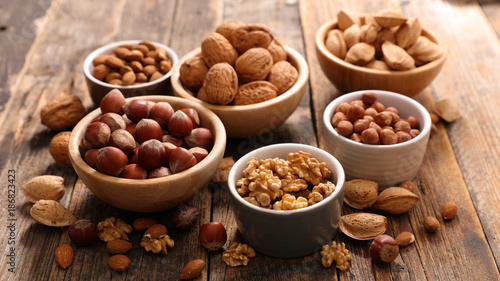 assorted nuts on wood background - 186823423