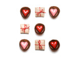 Minimal styled Valentine's Day flat lay top view isolated on white background. Gifts and chocolate heart-shaped candies in geometric rows. Copy space. Love concept. St Valentine's pattern - 186846416