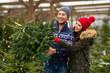 Couple buying Christmas tree
