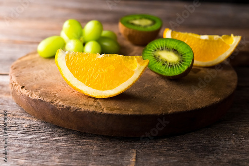 Fresh fruits on wooden background - 186849018