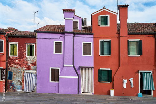 Tuinposter Venetie Burano, Venice. Colorful houses architecture at the square. Summer 2017, Italy