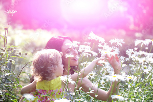 In de dag Purper Woman and child smile on sunny floral landscape