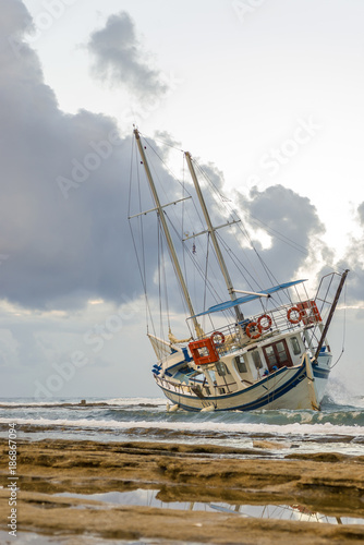 Fotobehang Schipbreuk Wrecked boat abandoned stand on beach in RHodes Greece