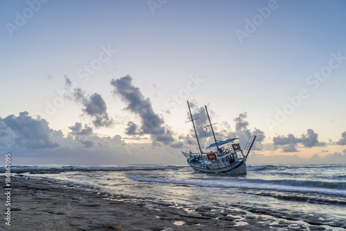 Foto op Canvas Schipbreuk Wrecked boat abandoned stand on beach in RHodes Greece