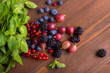 Berries on a wooden background - 186871236