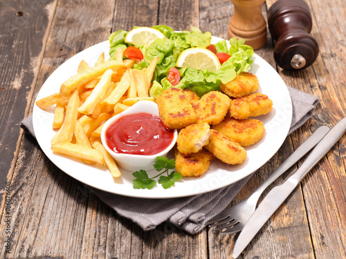 fried chicken,ketchup and french fries - 186876608