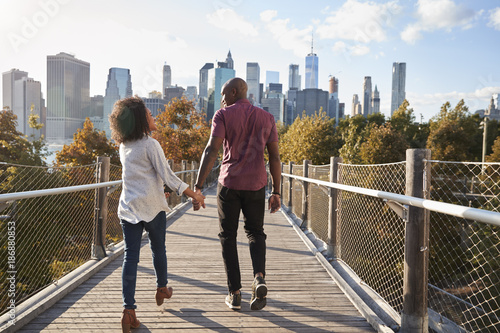 Couple Visiting New York With Manhattan Skyline In Background - 186880853