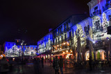 bars and restaurants with Christmas illuminations in the famous Como's square. Italy - 186890403