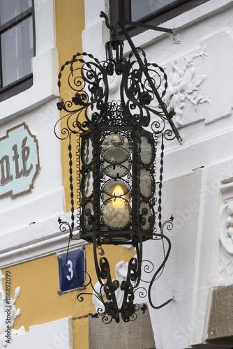 Close-up of illuminated electric lamp, Prague, Czech Republic Poster