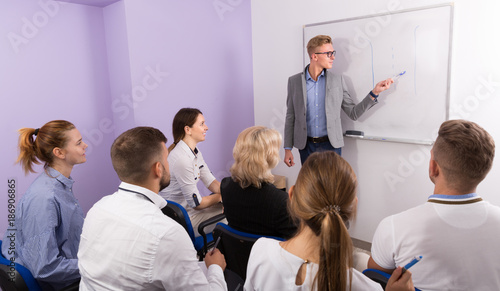 Foto op Canvas Snelle auto s Medical male lecturer answering near whiteboard
