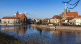 Panoramic view of Ostrow Tumski district in Wroclaw city with Collegiate Church of the Holy Cross and St Bartholomew, Cathedral of St John the Baptist, Archbishop's, palace from Oder River.