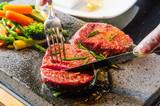 Steak cooked on lava-stone. - 186938231