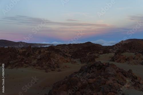 Foto op Canvas Grijze traf. Desert landscape with sunset light on mountains in background