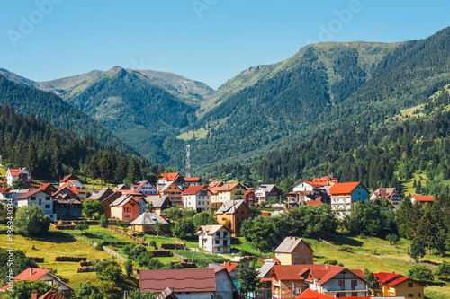 Tuinposter Groen blauw Small village in the Romanian Carpathians, summer season, Romania