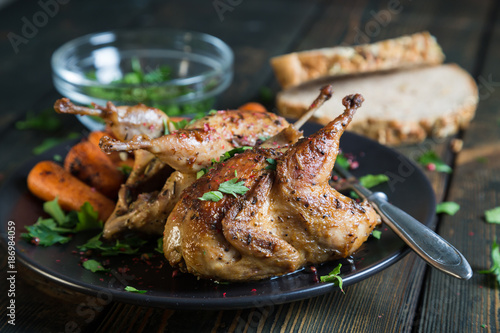 Fried quail with carrots and fresh parsley - 186984059