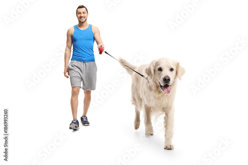 Young man in sportswear walking a dog Poster