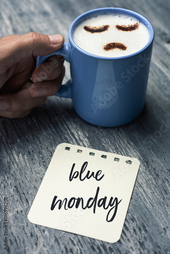Foto op Aluminium Kasteel cappuccino with a sad face and text blue monday