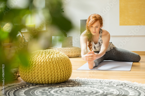 Woman exercising at home - 186997821