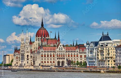 Panorama with building of Hungarian parliament at Danube river - 186998039