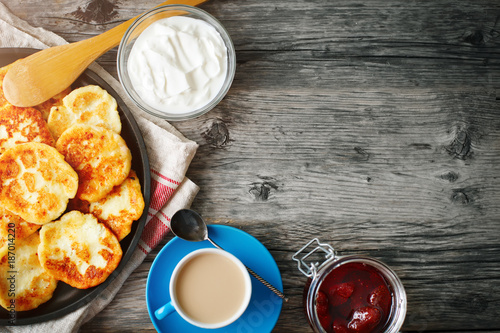 Delicious pancakes on wooden table with Cup of coffee and jam - 187014220
