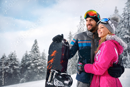 Couple enjoy skiing on mountain - 187020213