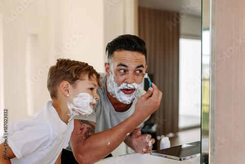 Foto Murales Father and son shaving together in bathroom