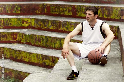 Fotobehang Basketbal sitting basketball player