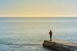 lone fisherman on the sea pier, sea fishing