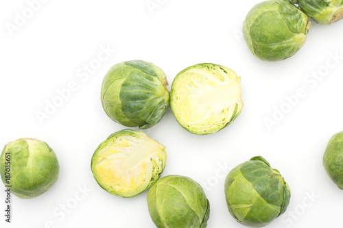 Papiers peints Bruxelles Raw Brussels sprout heads and two halves top view isolated on white background.