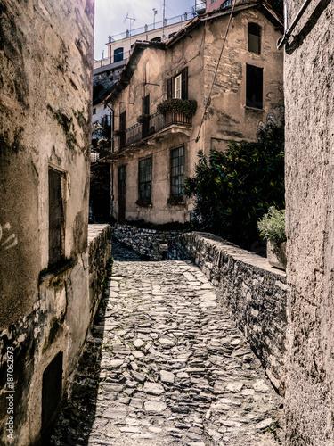 Poster Smal steegje very old and interesting stone bridge in Moltrasio, Como Lake, Italy