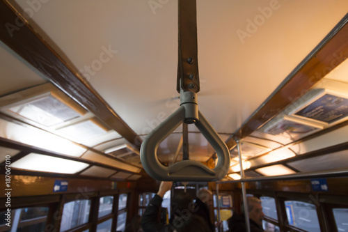 Commuter handle on a historical yellow tram