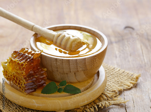 natural organic honey and honeycomb on a wooden table