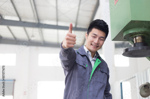 young asian man works in workshop