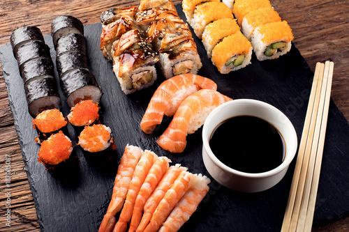 Foto op Canvas Sushi bar Sushi Set nigiri, sushi rolls and sashimi.