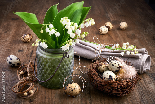 Fotobehang Lelietjes van dalen Lily of the valley and Easter decorations on old oak wood