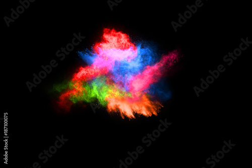 abstract colored dust explosion on a black background.abstract powder splatted background,Freeze motion of color powder exploding/throwing color powder, multicolored glitter texture. - 187100075