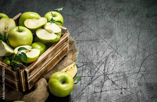 Green apples in an old box. - 187106820