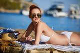 Sexy beautiful woman in white bikini on Mediterranean sea coast - 187116098