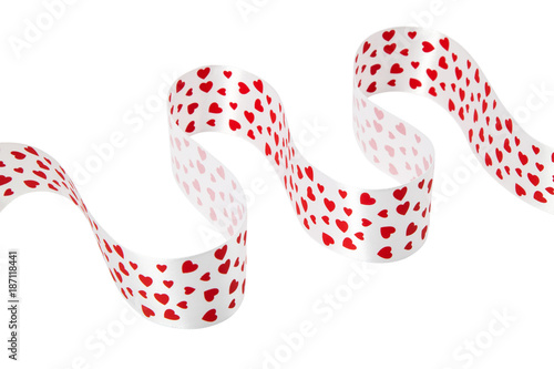 large satin white ribbon with red hearts lined with wave and carved on white clean background